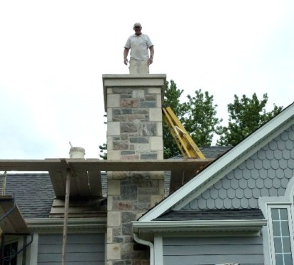 split fieldstone & elite blue granite sawn and chiseled chimney