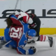 Nathan MacKinnon throws helmet at Conor Garland