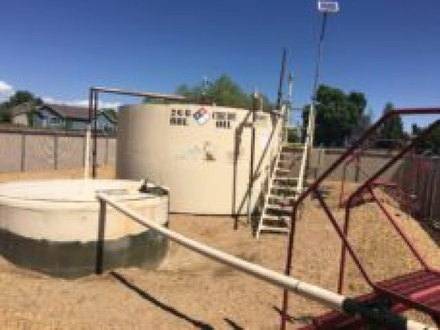 The tank battery at the site of Well A in Firestone. (Photo by Susan Greene.)