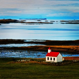 Late afternoon light bathes a small church near the Snæfellsnes Peninsula in western Iceland.