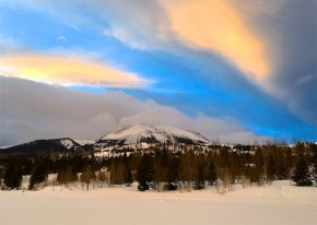A parting seam in the clouds over Buffalo Mountain, near Frisco, Colorado, offers a glimpse of the great blue beyond.