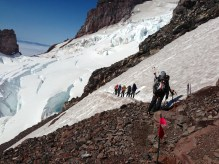 Part of our group crossing an area of rockfall hazard on the disappointment cleaver. Ingram glacier is ahead.