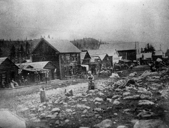 Early Breckenridge rocky main street with log buildings