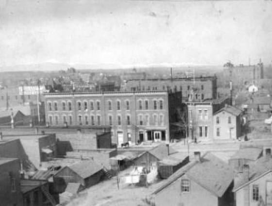 North side view of the city shows business and residence.  Grand Hotel and Pikes Peak are in the background, 1890-1910.