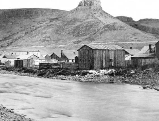 Golden - View across Clear Creek and wood frame buildings, 1860s