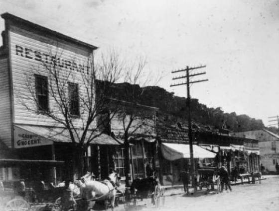 Morrison - Bear Creek Ave., Restaurant, Cash Grocery, surrey buggies & backboard,1880s