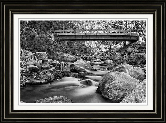 a black and white monochrome fine art photography scenic colorado nature landscape view of a rural rustic bridge crossing the south st vrain creek