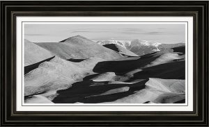 Monochrome Sand Dunes And Rocky Mountains Panorama Framed Print
