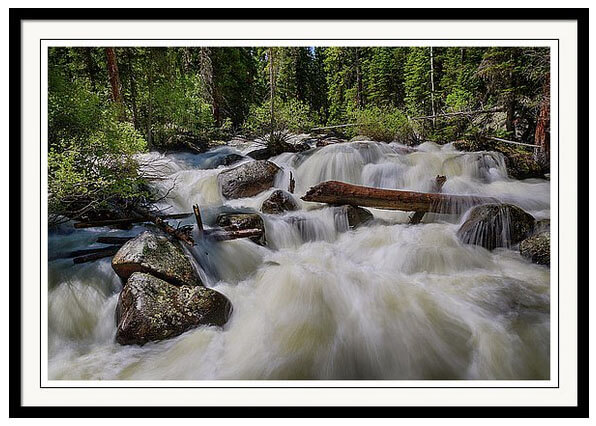Silky Cascading Stream Framed Print