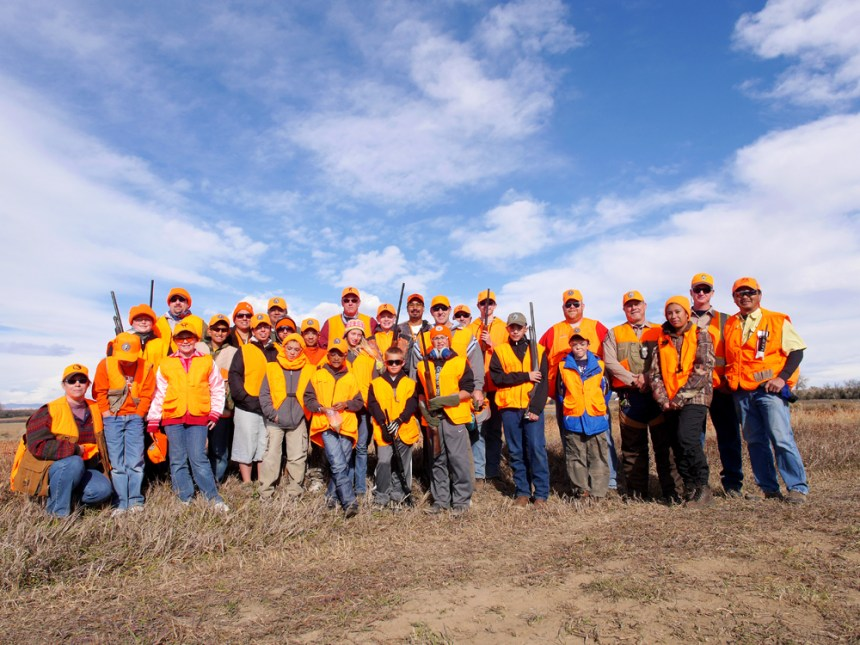A group of hunters poses for a photo at the end of a NHP pheasant hunt. Photo by Jerry Neal/CPW.