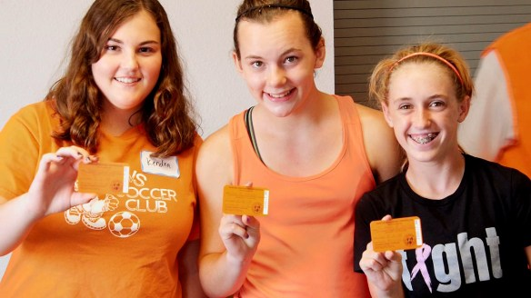 Students pose with their hunter education cards at a CPW field day. Video capture by Jerry Neal/CPW.