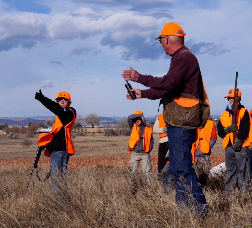 A young hunter seeks direction on a pheasant hunt. Photo by Jerry Neal/CPW.