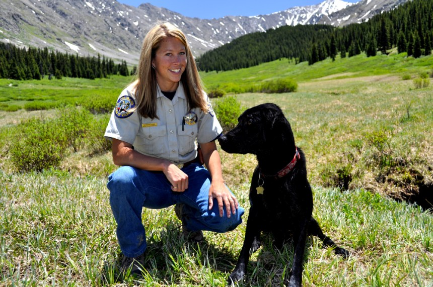Shannon Schaller and her black Lab on patrol in Summit County. Photo by Jerry Neal/CPW.