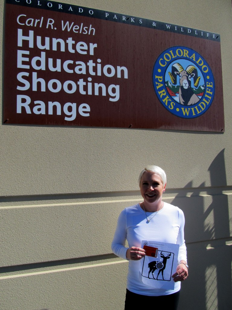 Miller poses with her hunter education card.