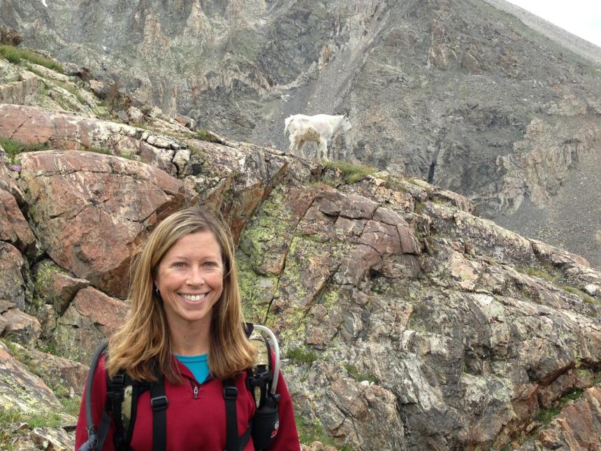 Shannon Schaller poses for a photo on a scouting trip for goats. Photo by CPW.