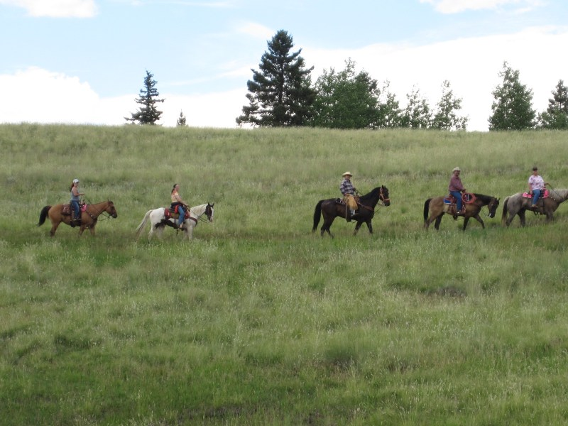Equestrians enjoy a trail ride at Mueller.