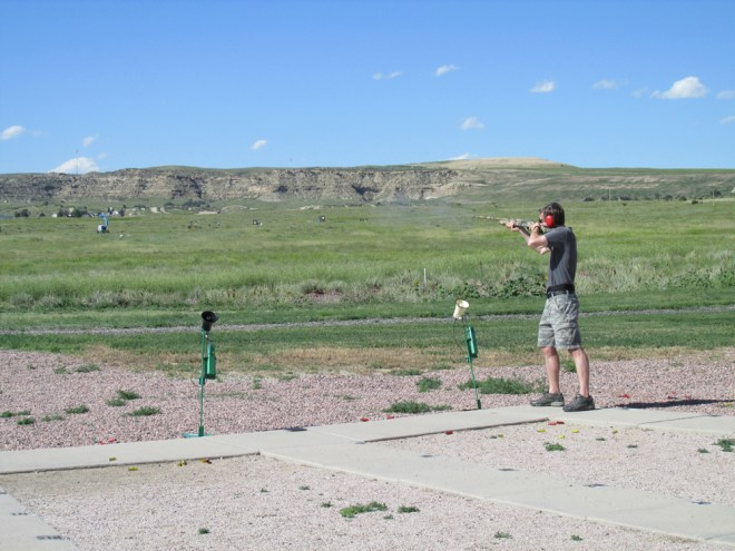 The author aims at a clay pigeon at the Pikes Peak Gun Club.
