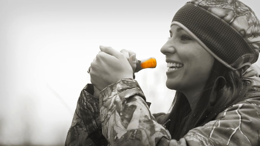 Cathy Brons practices with a duck call