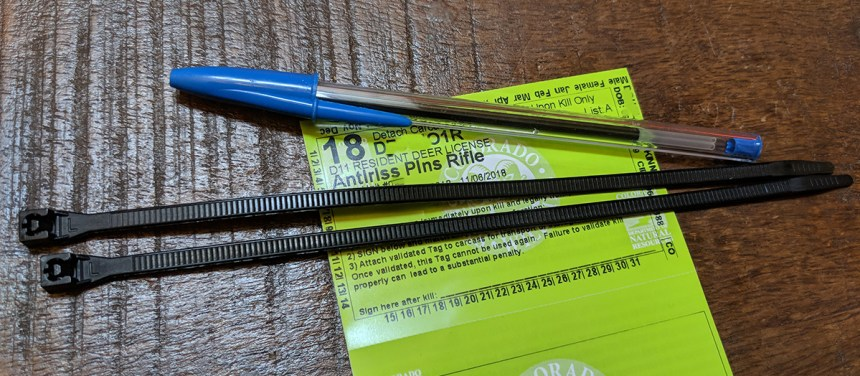 Hunting license, wire ties and pen