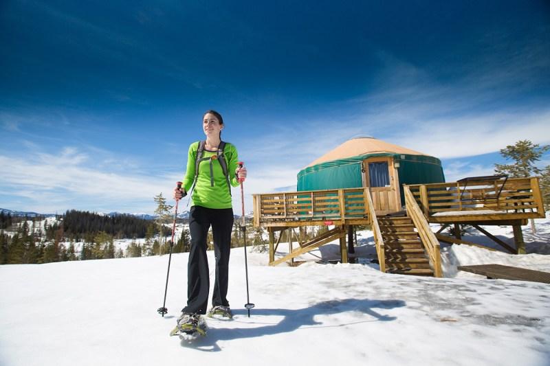snowshoeing past yurt