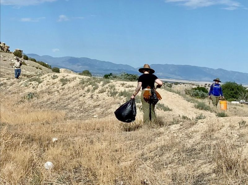 Volunteers collect bags of trash