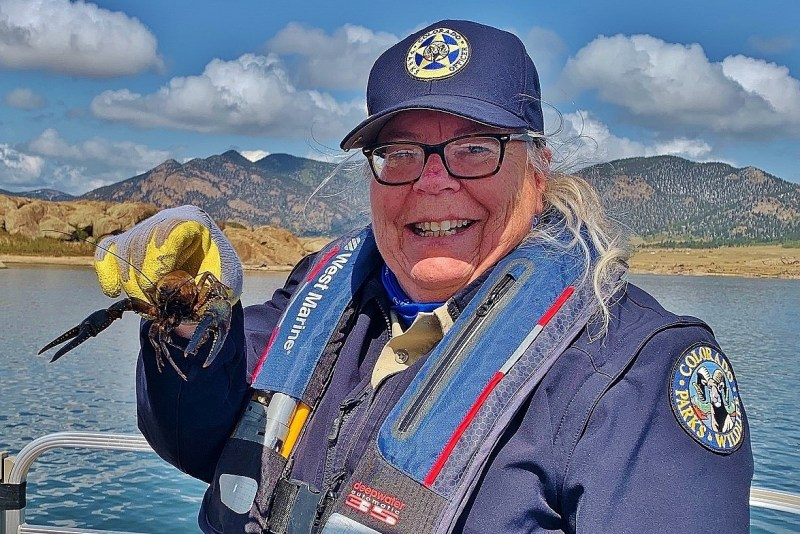 Darcy Mount shows off a crayfish she caught on a fishing expedition at Eleven Mile State
