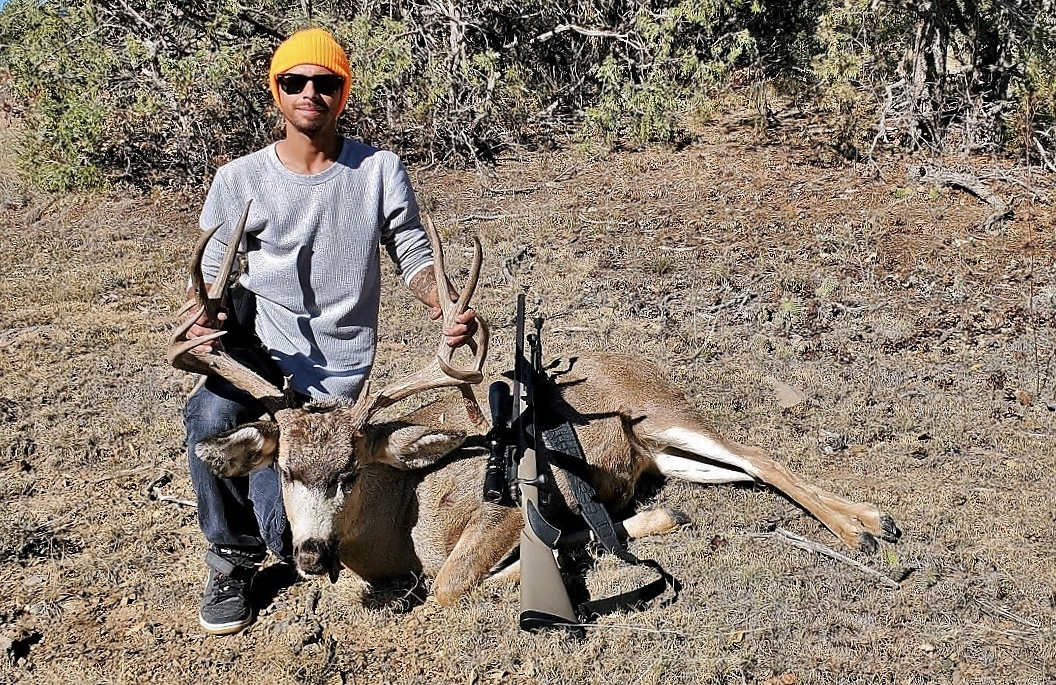 Hunter with a Mule Deer