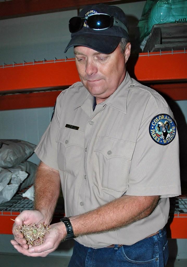 Jim Garner displays a handful of native seeds