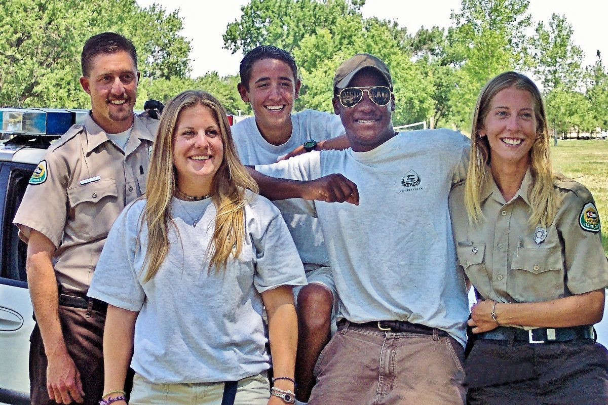 hoto shows her with four members of the boat patrol team and another shows a large group of fulltime and seasonal park rangers in 2003.