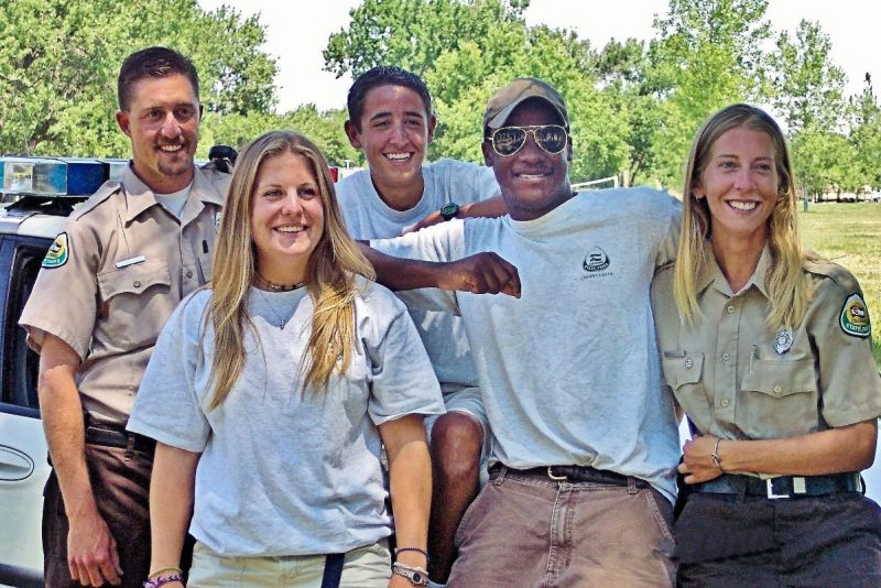 Photo shows her with four members of the boat patrol team and another shows a large group of fulltime and seasonal park rangers in 2003.
