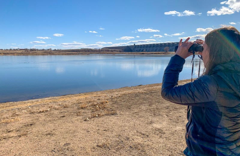 Jamey Hastings scans the sky and water at John Martin Reservoir State Park