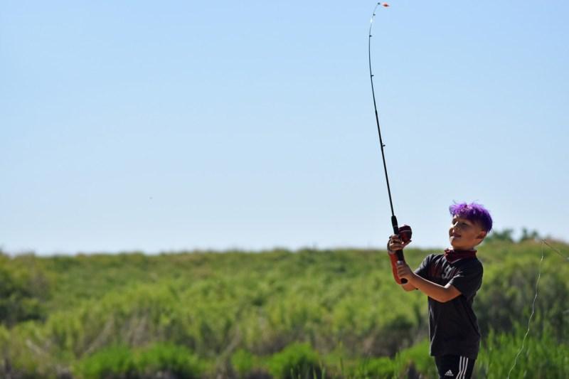 Jaysen Davis, 8, enjoyed his first time fishing at Lake Mary at Rocky Mountain Arsenal.