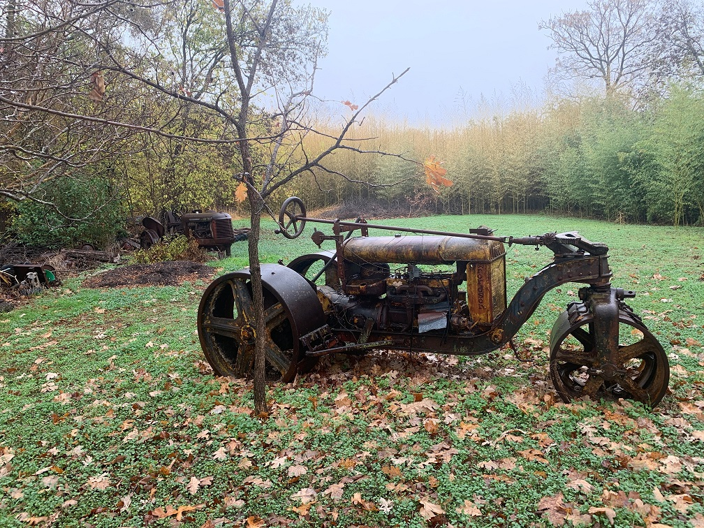 Antique tractor in a yard.