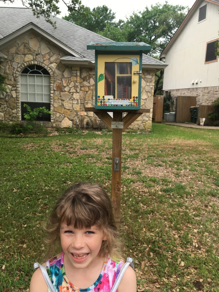 Rosie by a Little Free Library