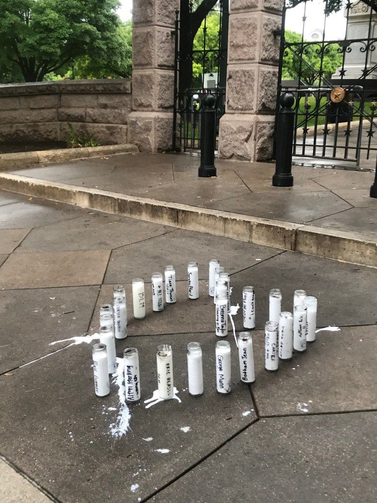 Candles left by demonstrators
