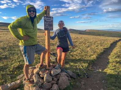 couple standing at the sign of the high point