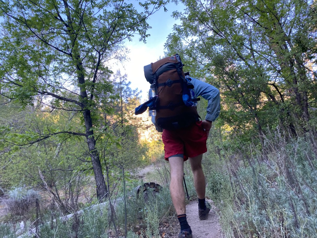 Author hikes with an old backpack, demonstrating its utility