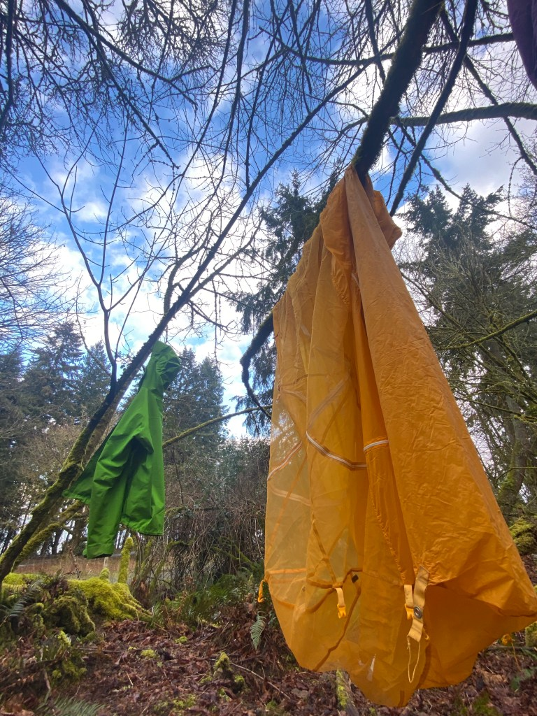 backpacking gear drying after rainstorm