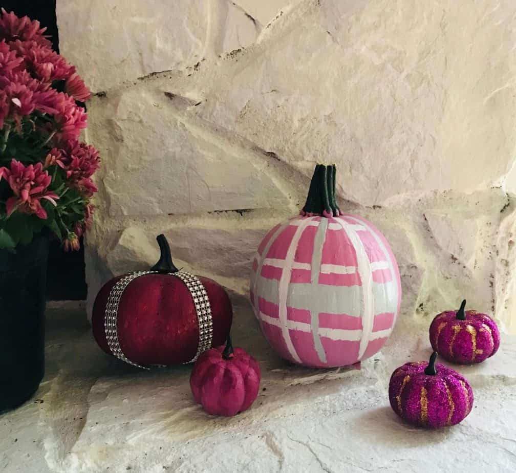 Painted pumpkins looking great on your fireplace.