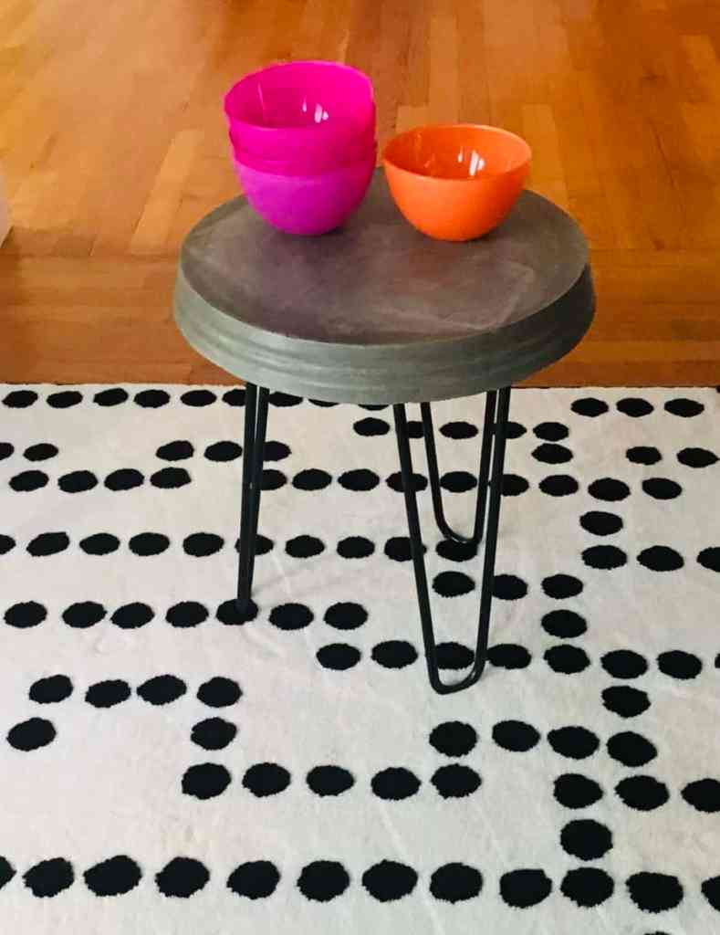 Finished concrete side table with bowls