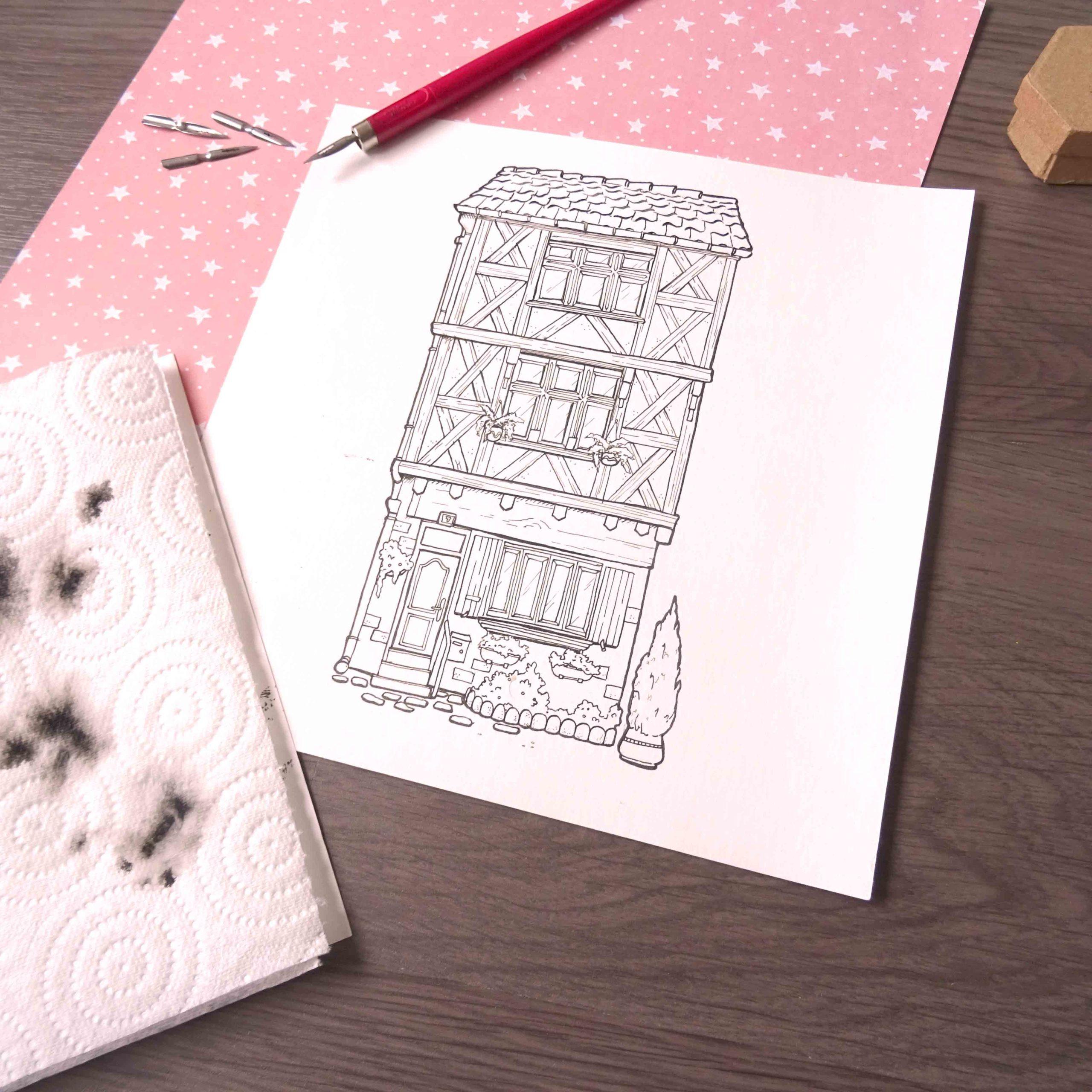 Illustration : photo de l'illustration d'une maison à colombage faite à l'encre de chine