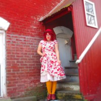 on modernity (vintage florals, pink coat, red hat, & yellow tights)