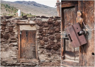 Entrance to a house with a wall of stones with dung patties and an unusual lock