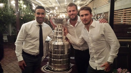 Johnny Oduya, Viktor Stalberg and Marcus Kruger pose with their hard-earned prize in Stockholm. (Photo via Phil Pritchard, Hockey Hall of Fame.)