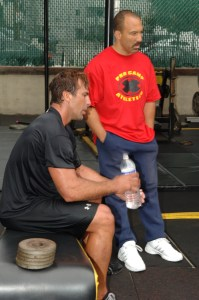 Goodman and a sweat-drenched Chris Chelios take a workout break.