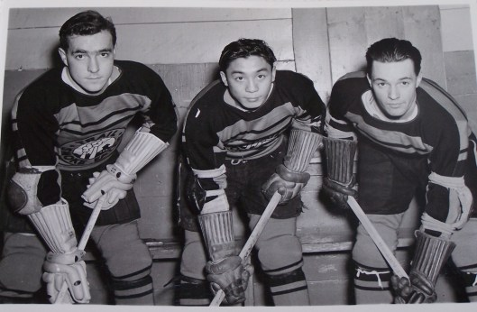 Hockey has come a long way from the days when Larry Kwong, center,  played (Photo/Chad Soon).