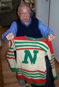 Larry Kwong with jersey sent to Hockey Hall of Fame.