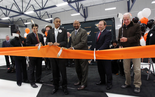Ed Snider, far right, NHL Commissioner Gary Bettman, and then-Philadelphia Mayor Michael Nutter, cut a ribbon dedicating a renovated Laura Sims Skatehouse at Cobbs Creek Park in November 2011.