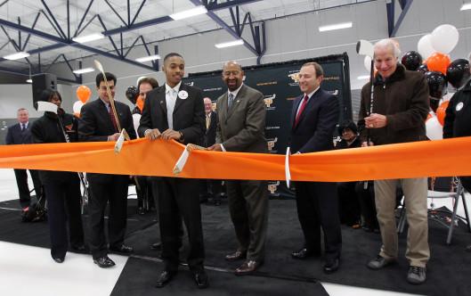 Ed Snider, far right, NHL Commissioner Gary Bettman, and then-Philadelphia Mayor Michael Nutter, cut a ribbon dedicating a renovated Laura Sims Skatehouse at Cobbs Creek Park in November 2011.