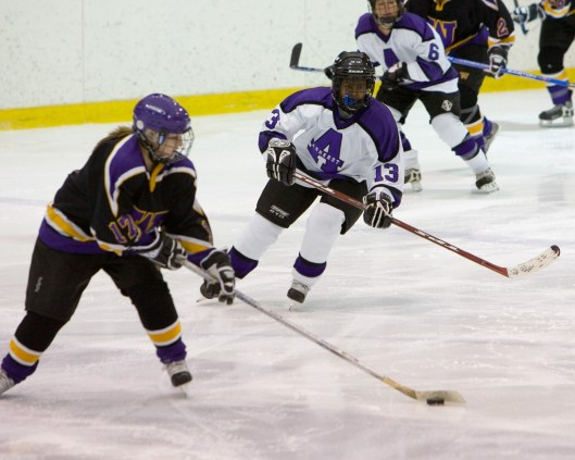 Detroit Hockey Association grad Tarasai Karega, right, earned an NCAA title with Amherst College.